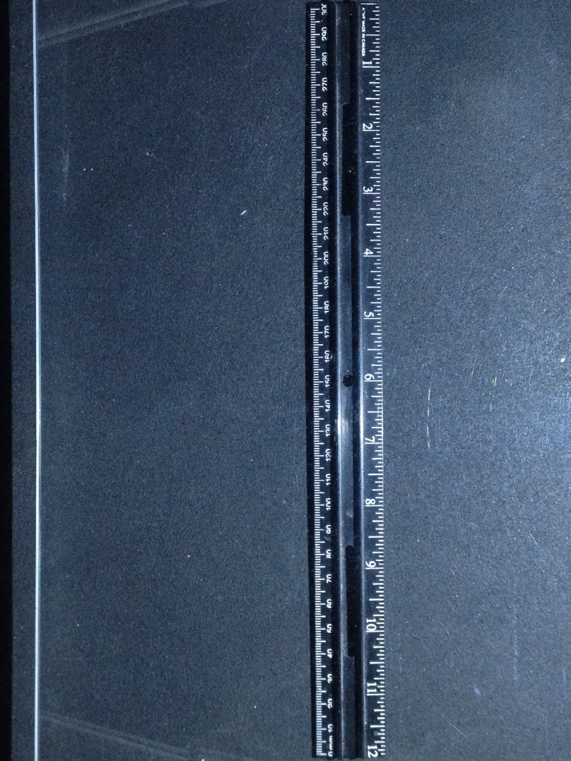 Scanner 900 - 12 inch vertical ruler - black background - with light at night (middle hole) - @33%.jpg